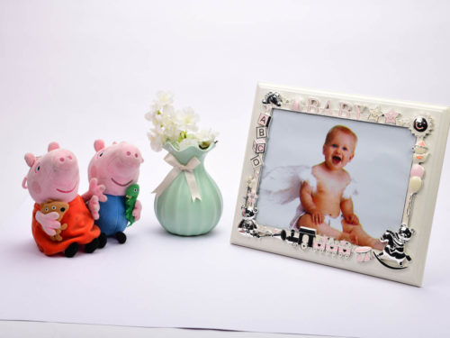 silver_enameled_children_photo_frame_on_wood